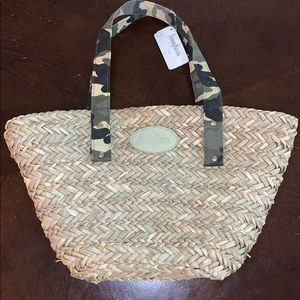 Newman Marcus straw tote with camouflage handles